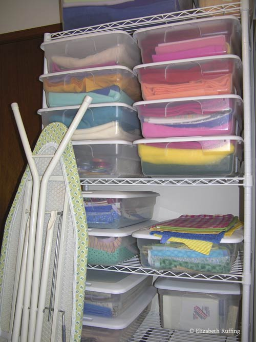 Sewing supply shelf with fabric in boxes