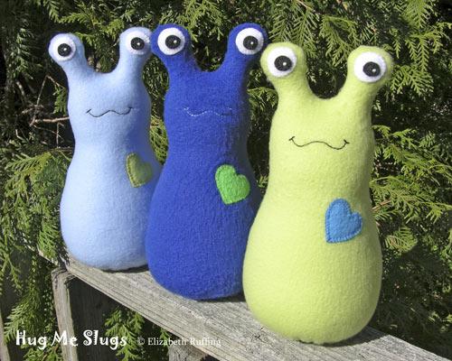 Light blue, Dark royal, and light green fleece Hug Me Slugs by Elizabeth Ruffing