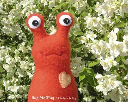 Deep Red-orange Fleece Hug Me Slug by Elizabeth Ruffing, with Mock Orange