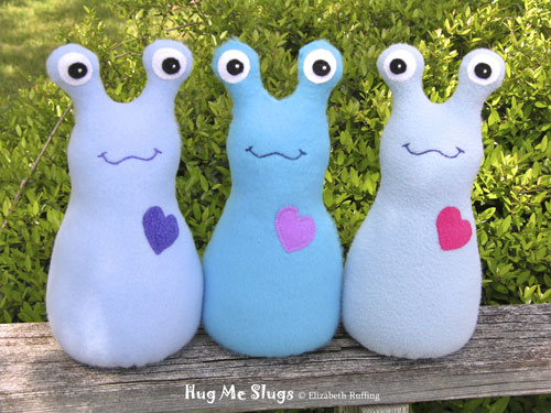 Baby blue, turquoise, and light blue Fleece Hug Me Slugs by Elizabeth Ruffing