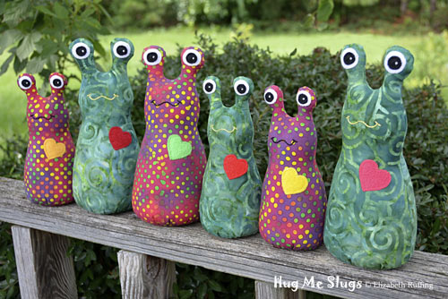 Red and Green Batik Hug Me Slug Art Toys by Elizabeth Ruffing