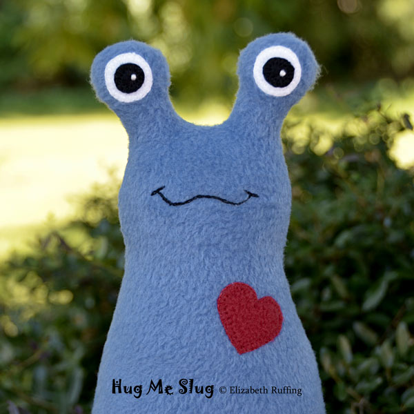 Copper-colored Fleece Hug Me Slug by Elizabeth Ruffing