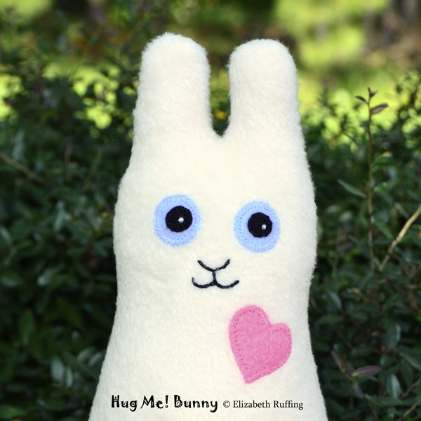 Cream and light camel fleece Hug Me Bunny Rabbits by Elizabeth Ruffing