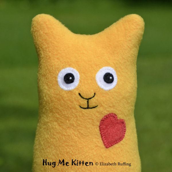 Gold fleece Hug Me Kitten by Elizabeth Ruffing
