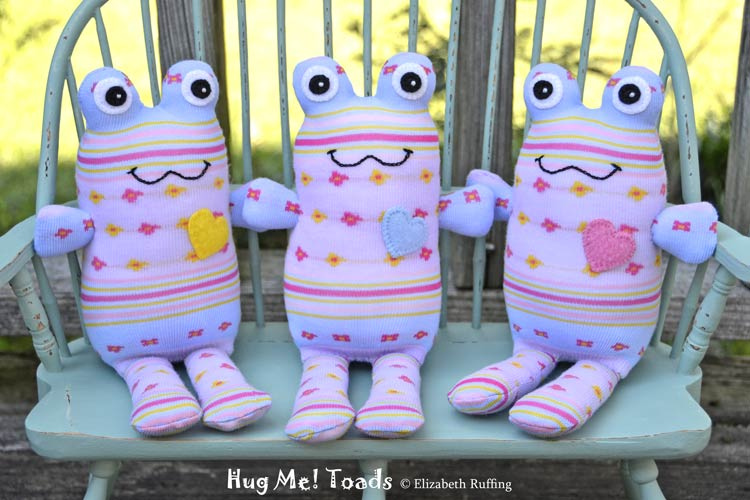 Hug Me Sock Toads, Lavender, light blue, pink, and yellow by Elizabeth Ruffing