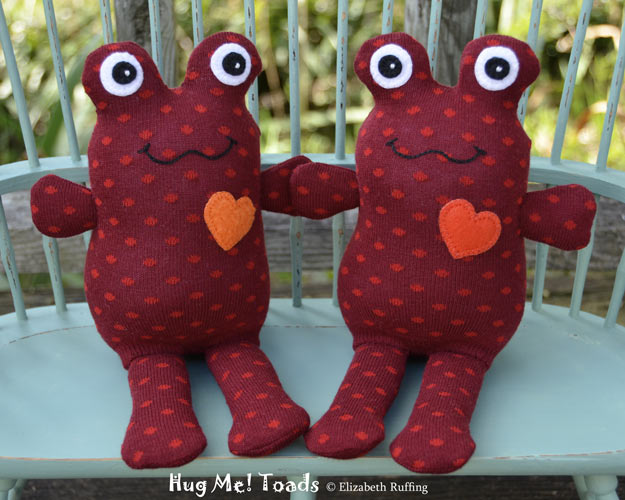 Hug Me Sock Toads, Dark red and red polka dots with orange hearts, by Elizabeth Ruffing