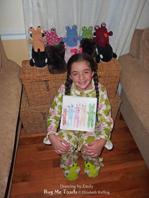 Emily with her drawing of her Hug Me Toad collection