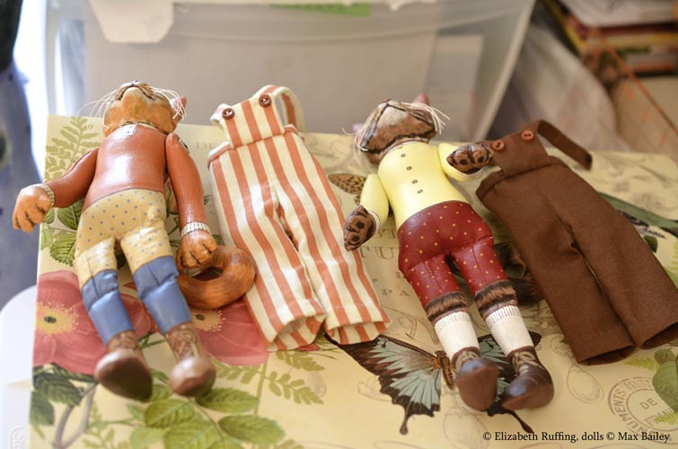 Photographing art dolls, organizing cat doll overalls, photo by Elizabeth Ruffing