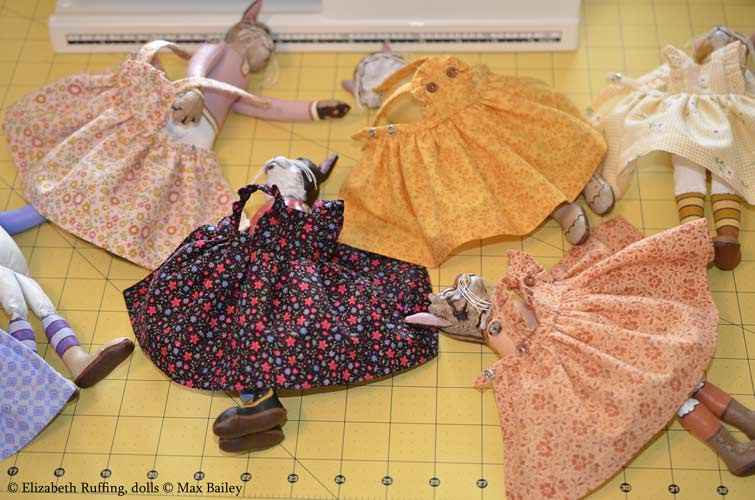 Photographing art dolls, organizing cat doll dresses, photo by Elizabeth Ruffing