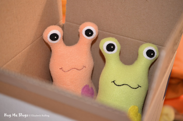 Light orange and pear green Hug Me Slug art toys by Elizabeth Ruffing, ready to ship