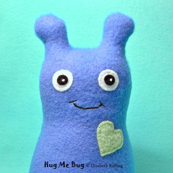 Cobalt fleece Hug Me Bug, original art toy by Elizabeth Ruffing