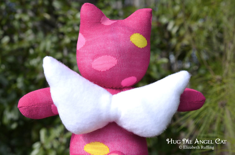 Magenta Hug Me Angel Cat Sock Kitten with yellow and pink polka dots, original art toy by Elizabeth Ruffing, wings