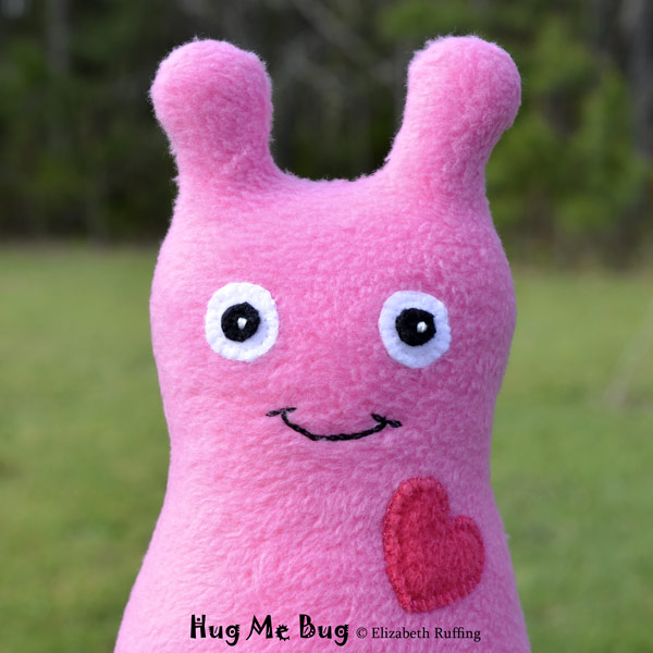 Medium Pink Fleece Hug Me Bug, original art toys by Elizabeth Ruffing
