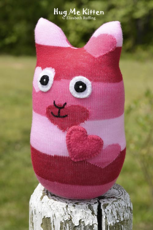 Red and pink striped Hug Me Sock Kitten, with heart design original art toy by Elizabeth Ruffing