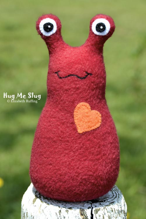 Red Hug Me Slug, original art toys by Elizabeth Ruffing