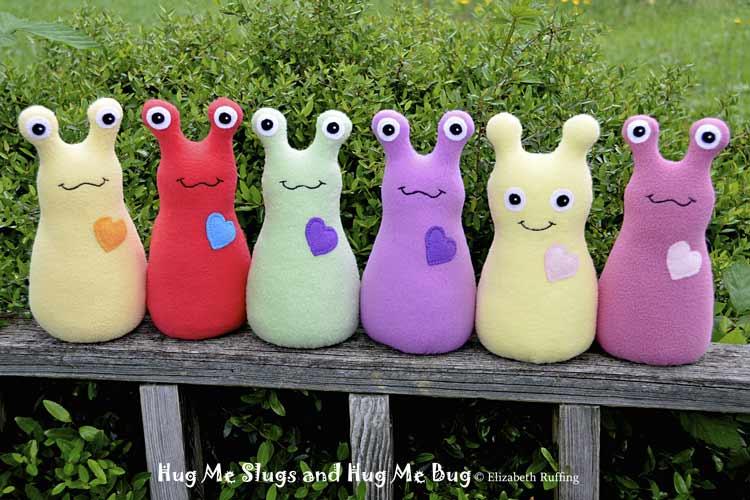 Assorted fleece Hug Me Slugs, original art toys by Elizabeth Ruffing
