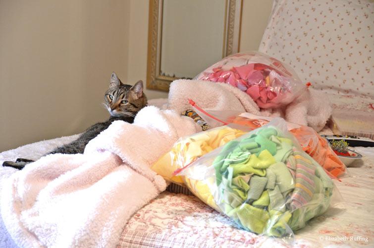 Tabby cat helper with fleece remnants by Elizabeth Ruffing