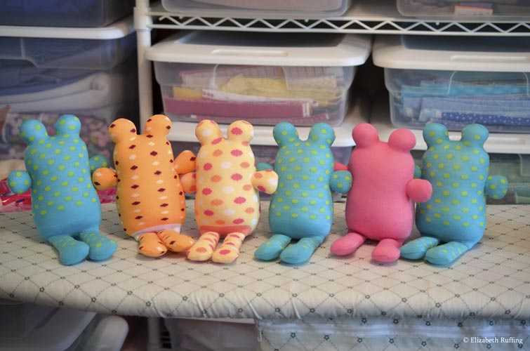 Assorted Hug Me Sock Toads, in progress, original art toys by Elizabeth Ruffing