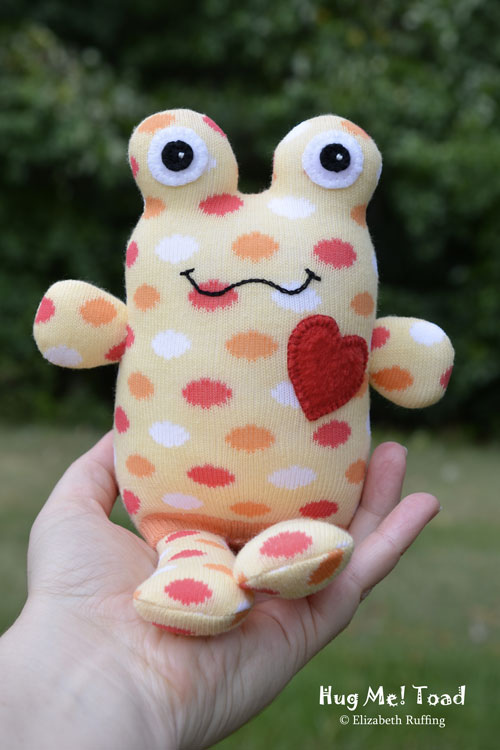 Soft yellow Hug Me Sock Toad with polka dots, original art toy by Elizabeth Ruffing