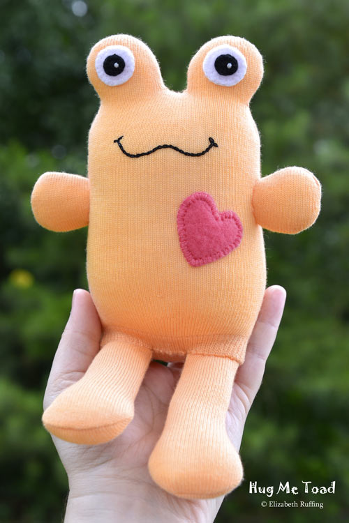 Soft orange Hug Me Sock Toad, original art toy by Elizabeth Ruffing