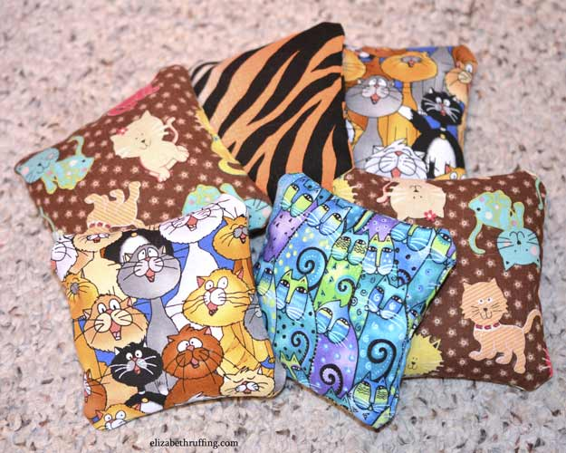 Catnip squares stuffed in assorted cat print fabrics, by Elizabeth Ruffing