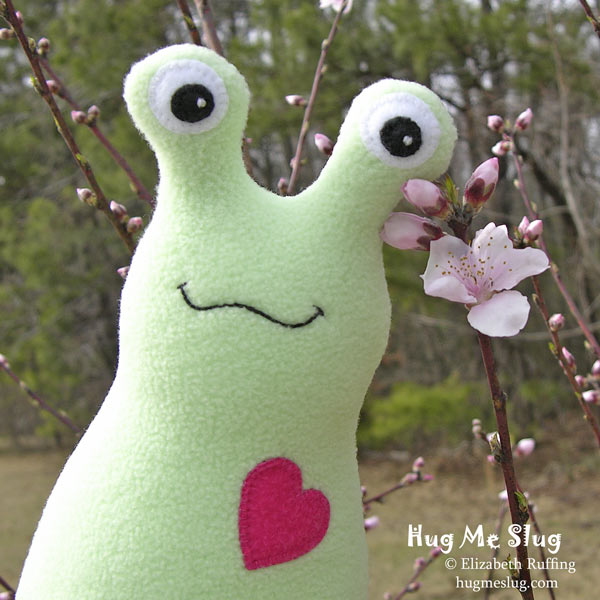 Slugterra and mint green fleece Hug Me Slug with peach blossom, original stuffed animal art toy by Elizabeth Ruffing