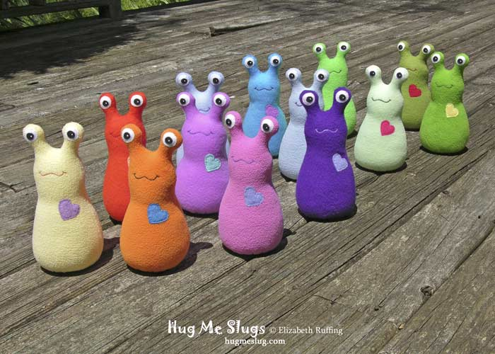 Slugterra and  assorted colored fleece Hug Me Slugs, original stuffed animal art toy by Elizabeth Ruffing