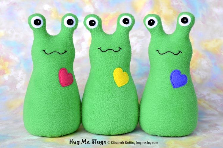 Slugterra and bright medium green fleece Hug Me Slugs, original stuffed animal art toy by Elizabeth Ruffing