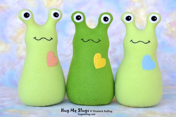 Green Hug Me Slugs, original stuffed animal art toys by Elizabeth Ruffing