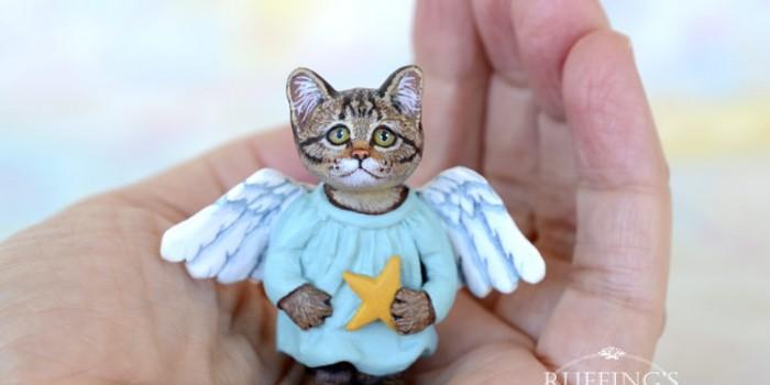 astrid-tabby-angel-kitten-hand