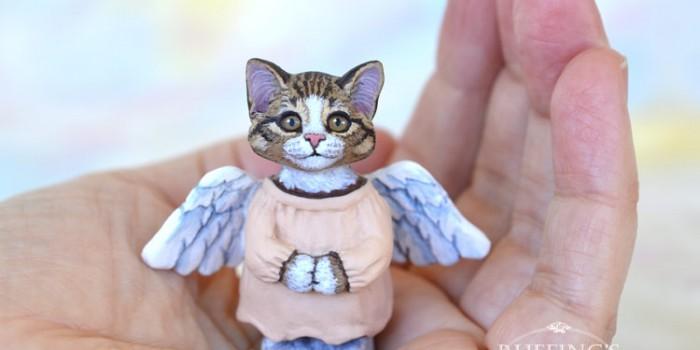 leila-tabby-white-kitten-hand