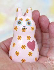 Buttons Bunnyton, original, one-of-a-kind miniature handmade peach-pink floral bunny rabbit art doll figurine by artist Elizabeth Ruffing