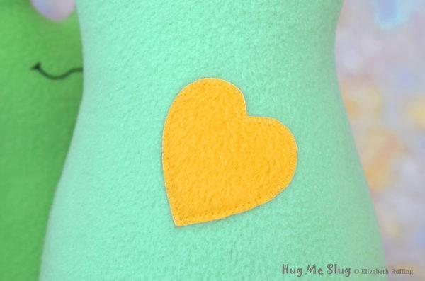 Handmade Aqua Hug Me Slug Stuffed Animal Plush Art Toy, Daffodil Yellow Heart, 12 inch, heart detail