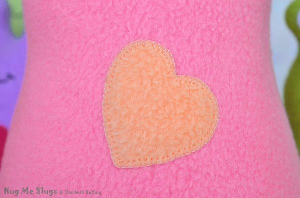 Handmade Medium Pink Hug Me Slug Stuffed Animal Plush Art Toy, Soft Orange Heart, 12 inch, heart detail