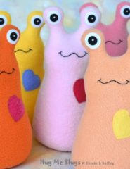Hug Me Slug handade stuffed animal plush toys, assorted colors, by Elizabeth Ruffing