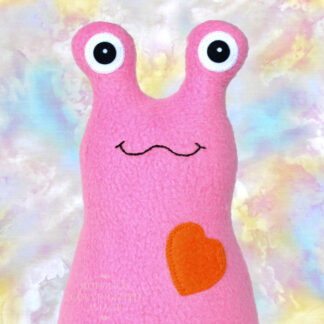 Handmade fleece Hug Me Slug plush toy, medium pink, orange heart by artist Elizabeth Ruffing