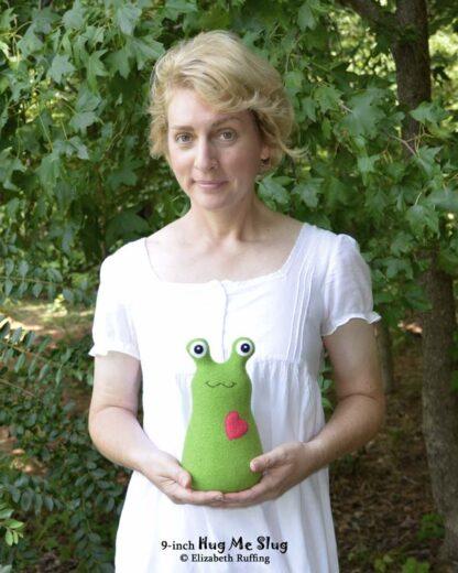 Elizabeth Ruffing holding 9-inch fleece Hug Me Slug plush toy
